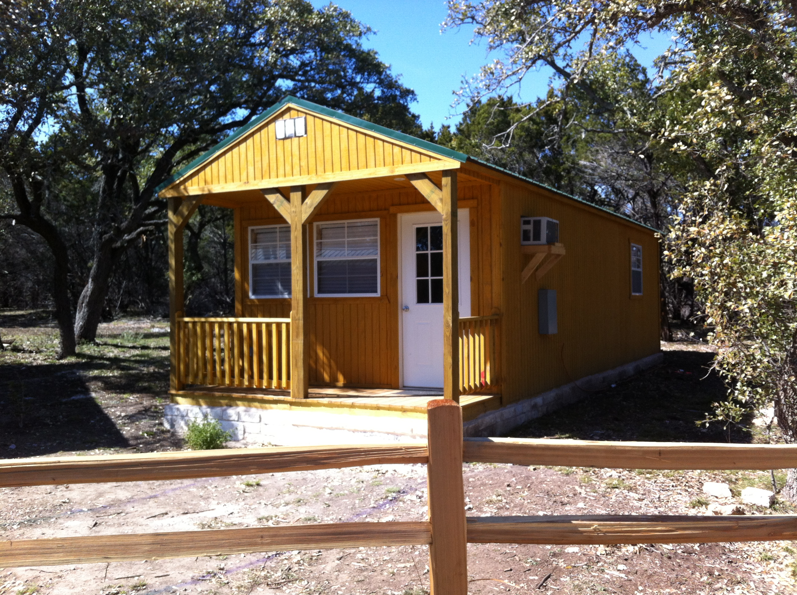 tx img waters accomodations some the in austin travis on retreat eco cabins lake living